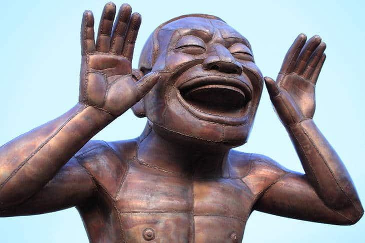 Bronze figure laughing - The joke's on you