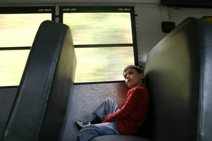 Young boy alone on school bus - The Deepest Wound