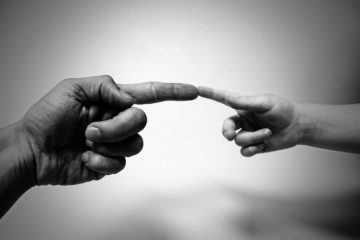 photo man and child's finger touching
