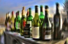 Blurry row of alcohol bottles - Thanking Anne Lamott