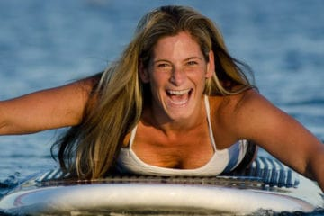 Ann Green on a surfboard