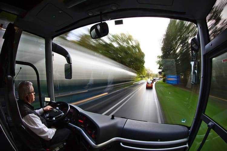 Man driving bus down blurry road - Choicelessly choosing choicelessness