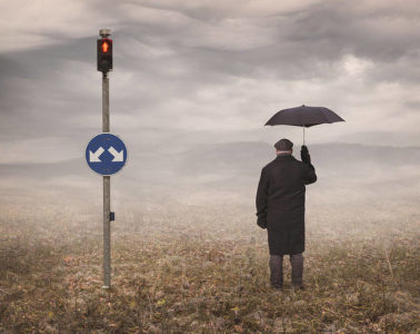 Man at crossroads with umbrella - Choicelessly choosing choicelessness