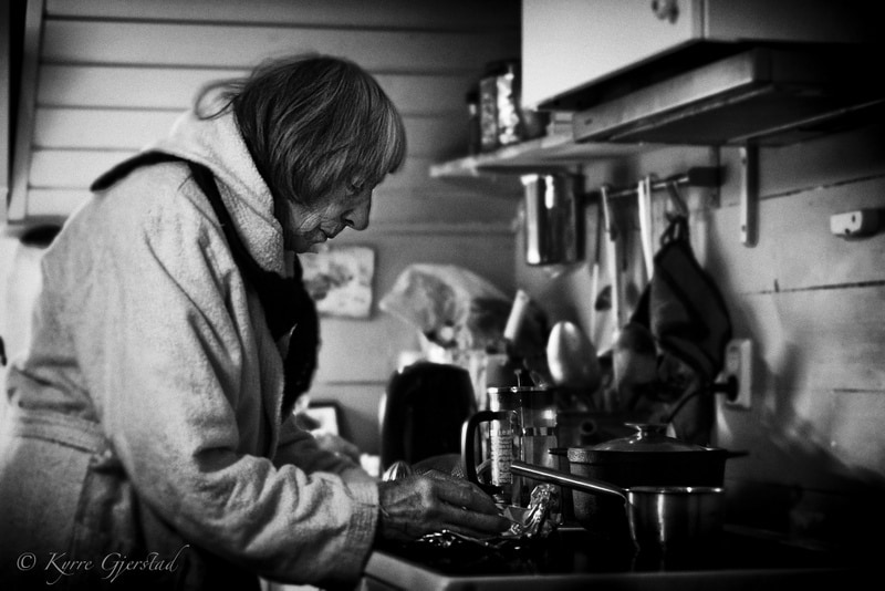 Grandmother cooking on old stove