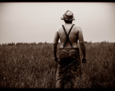 Father in a field