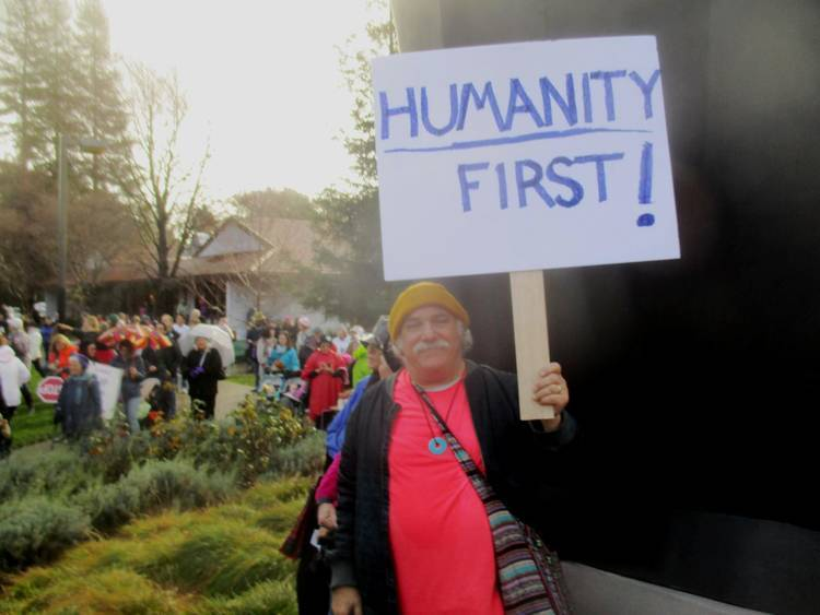 "Max Reif at Women's March with ""Humanity First!"" sign - Dialogue with my inner Donald Trump"