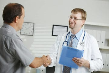 Doctor shaking patient's hand - We all contain multitudes