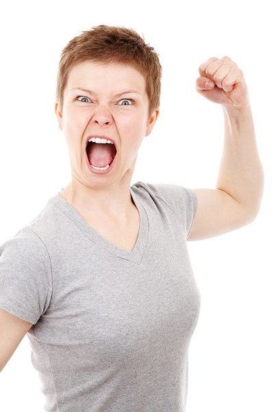 Angry woman making fist - You are the moment