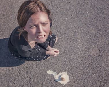 Women stressed with dropped icecream
