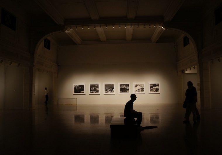shadow figure sitting in an art gallery