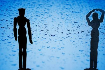 silhouette male and female puppets