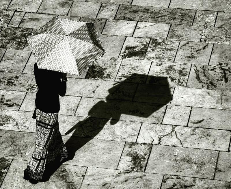 woman with umbrella with shadow