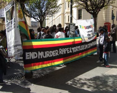 protesters in Zimbabwe with banner
