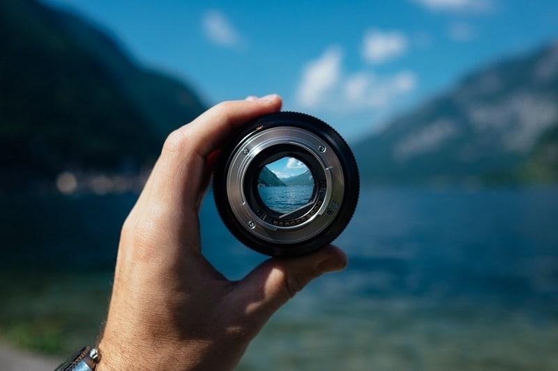 camera lens reframing a scene