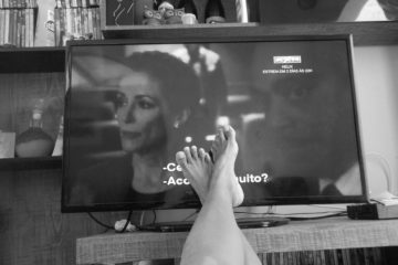 woman's feet in front of TV