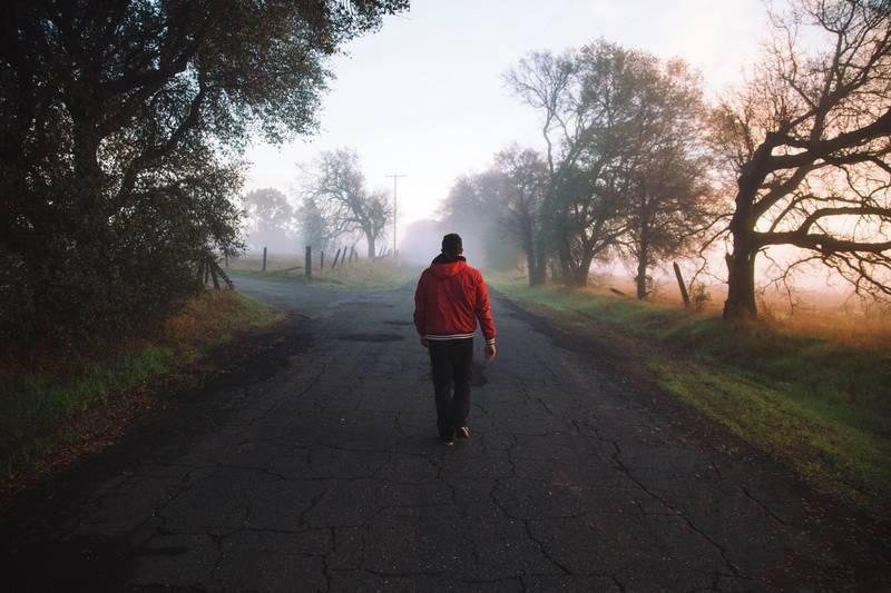 Man walking on path outdoors - Kundalini awakening