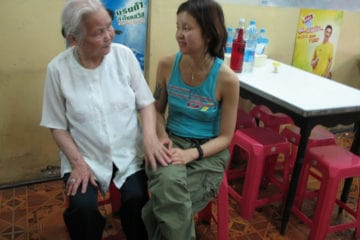 Ji and grandmother holding hands