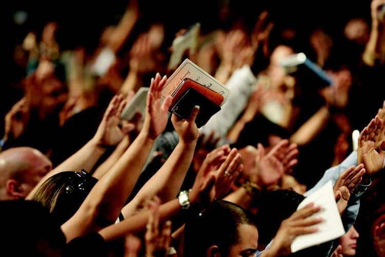 Christian congregation waving hands in worship - Nonsense and transcendent experience