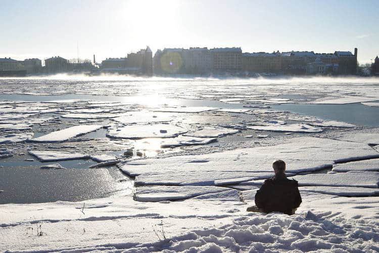 Man meditating on sunny day, in snow - An unconditional goodbye