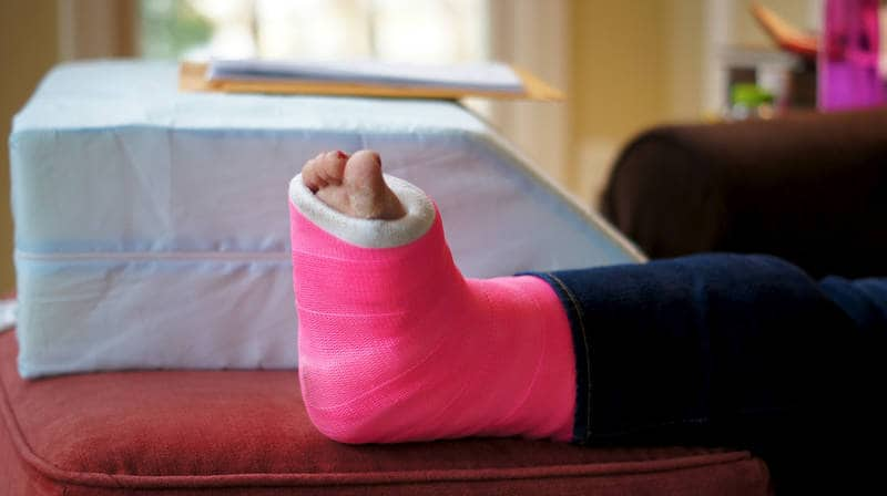 Foot in cast up on table - Writing about illness and injury