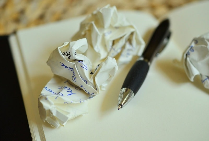 balled up paper and pen