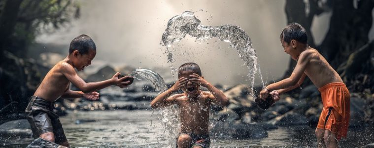 children splashing in water