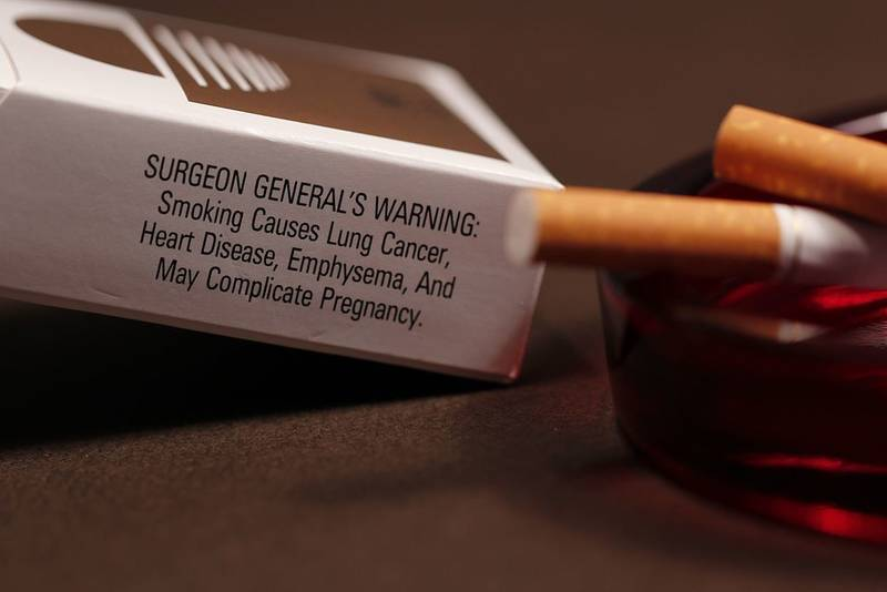 Cigarette package with surgeon general's warning about lung cancer - Confronting reality