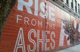 wall with rise from the ashes written on it