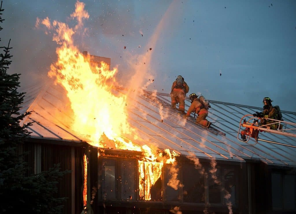 firemen putting out a fire in a building