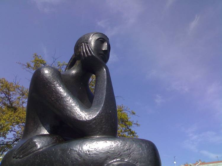 Statue of woman thinking - The energy of yes