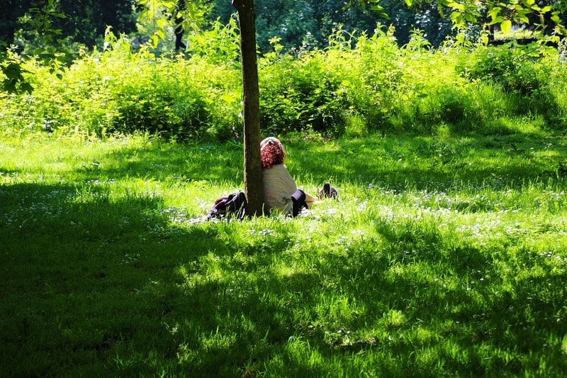 woman sitting alone in the park