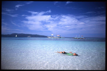 Man floating on back in water (Philippines) - Present-moment acceptance of waking-up-ness