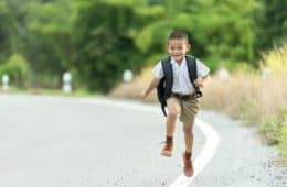 little boy skipping