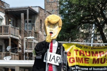 caricature of Trump with word 'liar'