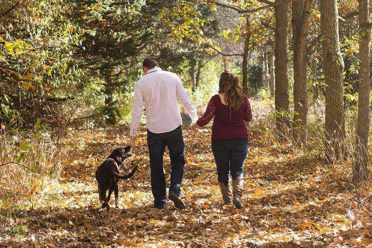 Couple walking dog on woodsy path - A blueprint for prosperity