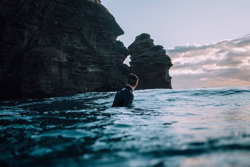 Man swimming in sea by clifftop - Dream interpretation