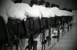 students in classroom taking an exam