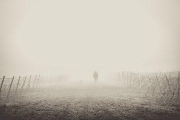 person walking in fog