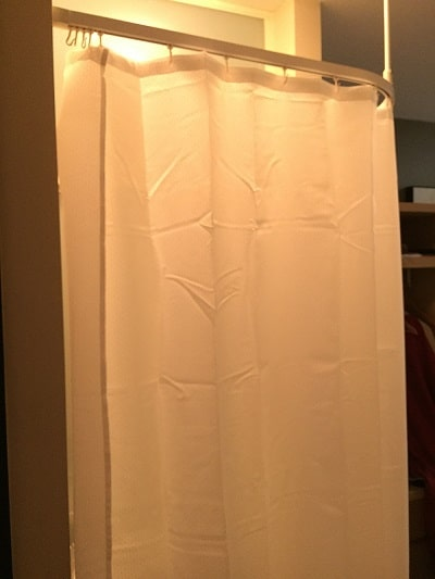 Shower curtain with washbasin behind it - Going down under and coming back up