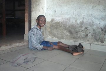 young disabled boy with a big smile