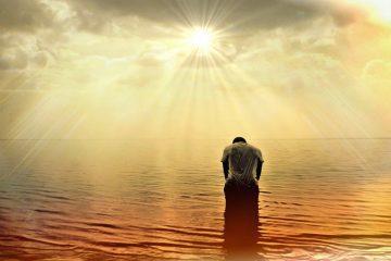 Man in the sea meditating