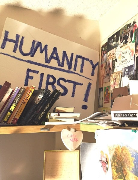 """""""Humanity First!"""" sign on bookshelf - After 9 months of Donald Trump"""