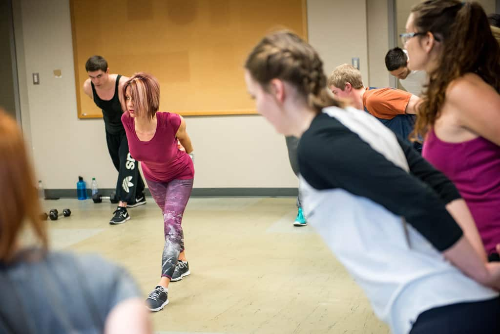 Group of men and women taking fitness class at university - Mass shootings and mass hatred