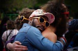 three people hugging