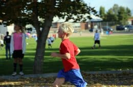 Young boy running through playground - Different is good