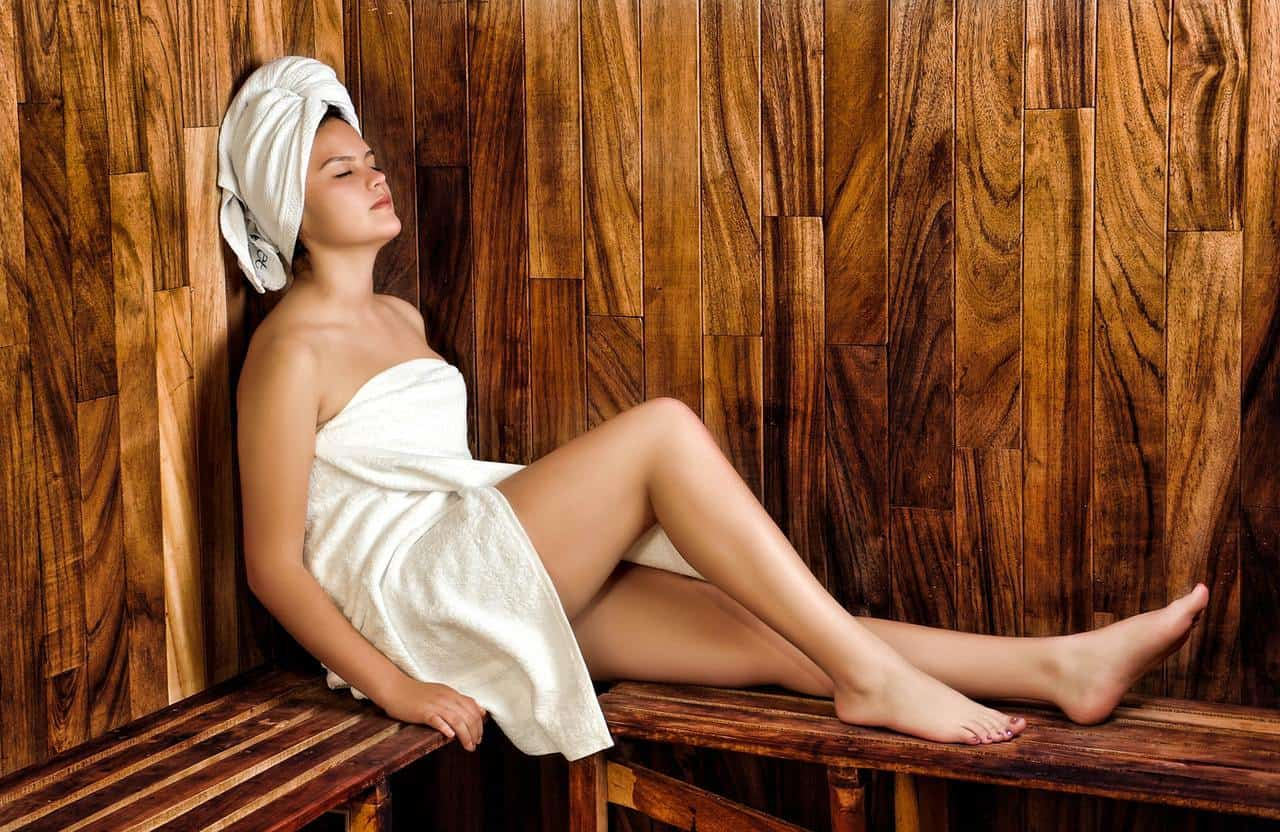 Woman in towel in sauna - The myth of romance