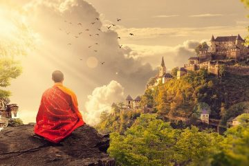 Buddhist monk meditating in mountains