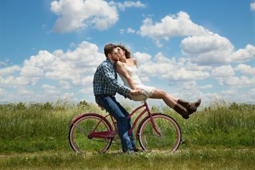 man and girl on bicycle