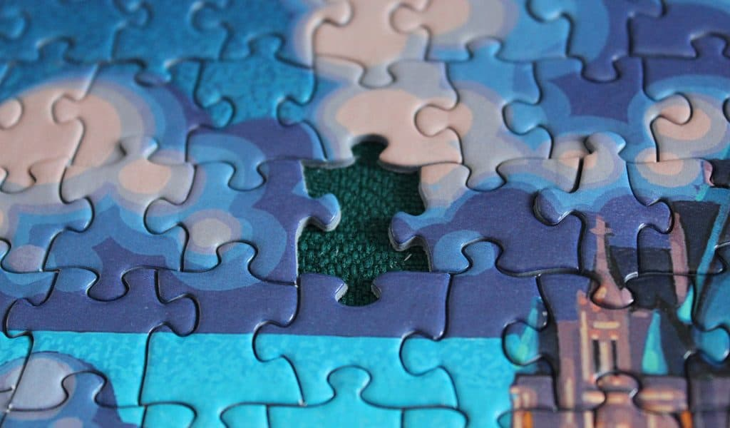 Blue jigsaw puzzle with one piece missing - The stories we're living