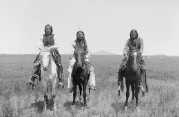 Three Comanche warriors on horseback - News of the World
